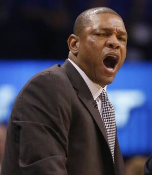Photo -                    Clippers coach Doc Rivers, left, reacts to a call by official Eric Lewis during Game 1.                     AP photo