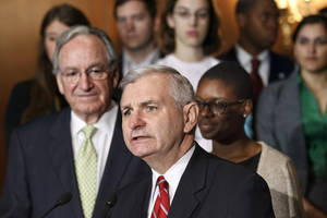 photo -   Sen. Jack Reed, D-R.I., center, accompanied by Sen. Tom Harkin, D-Iowa, left, and students, speaks at a news conference on Capitol Hill in Washington, Tuesday, May 8, 2012, as the Senate moves toward a showdown on a Democratic proposal to keep federally subsidized loan interest rates from doubling for millions of college students. Clarise McCants of Philadelphia, right, a Howard University political science major, added her own appeal to the senators. (AP Photo/J. Scott Applewhite)