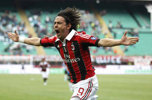 Photo - FILE - In this Sunday, May 13, 2012 file photo, AC Milan forward Filippo Inzaghi celebrates after scoring during a Serie A soccer match between AC Milan and Novara, at the San Siro stadium in Milan, Italy. Real Madrid's Champions League winning coach, Carlo Ancelotti, has backed former player Filippo Inzaghi as the ideal candidate to take over as manager of AC Milan. (AP Photo/Luca Bruno, File)