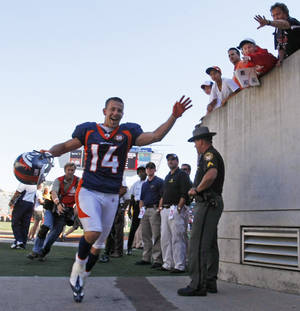 Photo -   FILE - In this Sept. 13, 2009, file photo, Denver Broncos receiver Brandon Stokley (14) runs off the field after the Broncos defeated the Cincinnati Bengals 12-7 in an NFL football game in Cincinnati. Stokley scored the winning touchdown. Stokley, who made one of the most famous catches in Broncos history, is returning to Denver to play with old friend Peyton Manning. Stokley signed a one-year deal with the Broncos on April 16, 2012. In June, he'll turn 36, the same age as Manning, whom he played with in Indianapolis from 2003-06. (AP Photo/Ed Reinke, File)