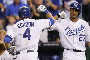 Photo - Kansas City Royals' Alex Gordon (4) is congratulated by Justin Maxwell (27) after hitting a home run in the third inning of a baseball game against the Boston Red Sox at Kauffman Stadium in Kansas City, Mo., Friday, Aug. 9, 2013. (AP Photo/Colin E. Braley)