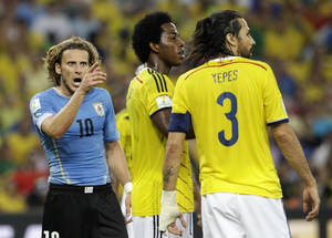 Photo - Uruguay's Diego Forlan, left, shouts at Colombia's Mario Yepes during the World Cup round of 16 soccer match between Colombia and Uruguay at the Maracana Stadium in Rio de Janeiro, Brazil, Saturday, June 28, 2014. (AP Photo/Matt Dunham)
