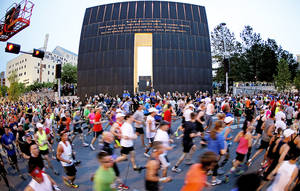 Photo - Runners flow past the Oklahoma City National Memorial & Museum at the beginning of the Oklahoma City Memorial Marathon in Oklahoma City, Sunday, April 29, 2012. Photo by Bryan Terry, The Oklahoman <strong>BRYAN TERRY</strong>