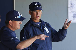 Photo - San Diego Padres manager Bud Black, right, talks with pitching coach Darren Balsley during a spring  training exhibition baseball game against the Cleveland Indians, Saturday, March 29, 2014, in San Diego. (AP Photo/Lenny Ignelzi)