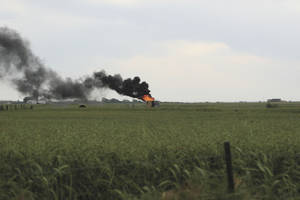 Photo - An oil tank battery caught fire in Union City Friday morning when it was hit by lightning <strong>Emily Kindiger, El Reno Tribune. - Emily Kindiger, El Reno Tribune.</strong>