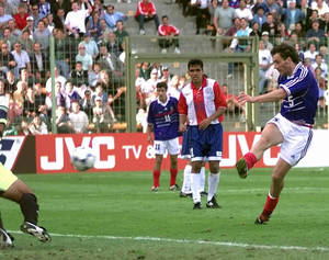 "Photo - FILE - In this Sunday, June 28, 1998 file photo,  France's Laurent Blanc scores against Paraguay in extra time of the soccer World Cup second round soccer match, at the Felix Bollaert stadium in Lens, France.  On this day: Blanc scored the first ""golden goal"" in World Cup finals history to give France a 1-0 win over Paraguay. (AP Photo/Luca Bruno, File)"
