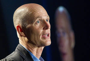 """Photo - FILE - In this May 16, 2012 file photo, Florida Gov. Rick Scott speaks in Fort Lauderdale. Florida Gov. Rick Scott, long opposed President Barack Obama's remake of the health insurance market. After President Obama won re-election, the Republican governor softened his tone. He said he wanted to """"have a conversation"""" with the administration about implementing the 2010 law.   (AP Photo/J Pat Carter, File)"""