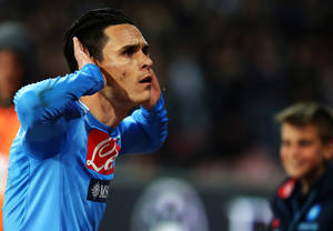 Photo - Napoli's Callejon celebrates after scoring during a Serie A soccer match between Napoli and Juventus, at the San Paolo stadium in Naples, Italy, Sunday, March, 30, 2014. (AP Photo/Salvatore Laporta)
