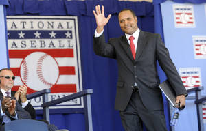 Photo -   Former Cincinnati Reds star Barry Larkin arrives on stage for his induction into the National Baseball Hall of Fame and Museum, Sunday, July 22, 2012, in Cooperstown, N.Y. (AP Photo/Tim Roske)