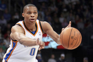 Photo - Thunder guard Russell Westbrook passes the ball during Oklahoma City's win over the New York Knicks on Monday. PHOTO BY HUGH SCOTT, THE OKLAHOMAN