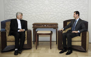 Photo -   In this photo released by the Syrian official news agency SANA, Iran's Supreme National Security Council, Saeed Jalili, meets with Syrian President Bashar Assad in Damascus, Syria, Tuesday, Aug. 7, 2012. (AP Photo/SANA)
