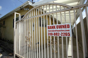 "photo - HOUSE EXTERIOR:    FILE - In this file photo taken July 21, 2010, a ""bank owned"" sign is seen on a home that is listed as a foreclosure on a HUD website, in Hawthorne, Calif. Nearly half of the homeowners who enrolled in the Obama administration's flagship mortgage-relief program have fallen out. (AP Photo/Reed Saxon, file) ORG XMIT: NYBZ148"