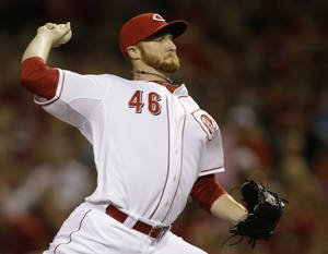 Photo - Cincinnati Reds relief pitcher Curtis Partch throws against the Pittsburgh Pirates in the eighth inning of a baseball game, Friday, July 11, 2014, in Cincinnati. Partch was the winning pitcher in the game won by Cincinnati 6-5. (AP Photo/Al Behrman)