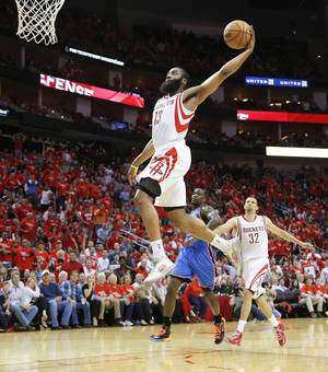 Photo - Houston's James Harden goes up for a dunk during Monday night's Game 4 of the Rockets' playoff series against the Thunder.  Photo by Bryan Terry, The Oklahoman