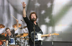 Photo - Ronnie Dunn performs at the Oklahoma Twister Relief Concert at the Gaylord Family-Oklahoma Memorial Stadium on Saturday, July 6, 2013 in Norman, Okla. (Photo by Alonzo Adams/Invision/AP)