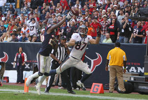 Photo - Denver Broncos wide receiver Eric Decker (87) catches a touchdown pass as Houston Texans cornerback Kareem Jackson (25) defends during the second half of an NFL football game on Sunday, Dec. 22, 2013, in Houston. (AP Photo/The Courier, Jason Fochtman)