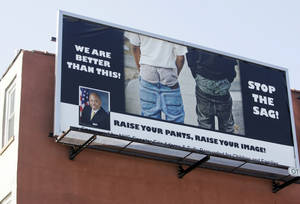 "Photo - A ""Stop the Sag!"" billboard is seen on the side of a building on Sterling Place and Franklin Avenue in the Brooklyn borough of New York, Thursday, April 1, 2010, bearing a message from New York State Sen. Eric Adams asking people to stop wearing their pants sagging below their waistline. (AP Photo/Robert Mecea)"