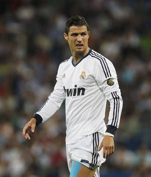 Photo -   Real Madrid's Cristiano Ronaldo from Portugal reacts after an injury during a Spanish La Liga soccer match against Granada at the Santiago Bernabeu stadium in Madrid, Spain, Sunday, Sept. 2, 2012. (AP Photo/Andres Kudacki)