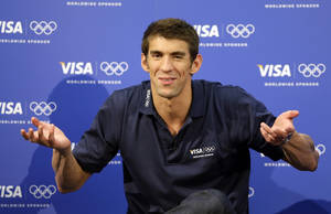 Photo -   United States swimmer Michael Phelps speaks during a news conference at the 2012 Summer Olympics, London, Sunday, Aug. 5, 2012. (AP Photo/Kirsty Wigglesworth)