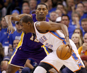 Photo - Oklahoma City's Kevin Durant (35) tries to get past Metta World Peace (15) during Game 1 in the second round of the NBA playoffs between the Oklahoma City Thunder and L.A. Lakers at Chesapeake Energy Arena in Oklahoma City, Monday, May 14, 2012. Photo by Bryan Terry, The Oklahoman