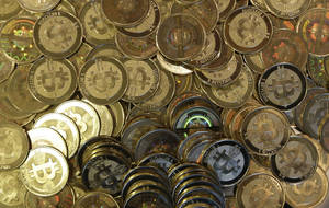 Photo - FILE - This April 3, 2013 file photo shows bitcoin tokens in Sandy, Utah.  The website of major bitcoin exchange Mt. Gox is offline Tuesday, Feb. 25, 2014, amid reports it suffered a debilitating theft, a new setback for efforts to gain legitimacy for the virtual currency.  (AP Photo/Rick Bowmer, File)