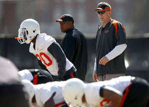 Photo - Oklahoma State defensive coordinator Glenn Spencer watches during an OSU spring football practice in Stillwater on Wednesday.  Photo by Bryan Terry, The Oklahoman