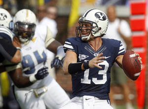Photo -   Brigham Young quarterback Riley Nelson (13) throws from the pocket in the first half of an NCAA college football game against Georgia Tech in Atlanta, Saturday, Oct. 27, 2012. (AP Photo/John Bazemore)