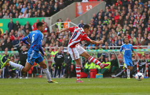 Photo - Stoke City's Peter Odemwingie, centre,  scores during the English Premier League soccer match against Hull City, at the Britannia Stadium, Stoke On Trent, England, Saturday March 29, 2014. (AP Photo/PA,  Dave Thompson) UNITED KINGDOM OUT