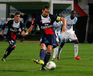 Photo - Paris Saint Germain's Swedish forward Zlatan Ibrahimovic, scores a penalty against Marseille, during their League One soccer match, at the Velodrome Stadium, in Marseille, southern France, Sunday, Oct. 6, 2013. (AP Photo/Claude Paris)