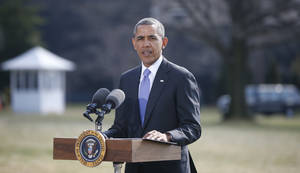 Photo - President Barack Obama makes a statement on Ukraine, Thursday, March 20, 2014, on the South Lawn at the White House in Washington before departing for Florida. President Barack Obama said the US is levying a new round of economic sanctions on individuals in Russia, both inside and outside the government, in retaliation for the Kremlin's actions in Ukraine. He also said he has also signed a new executive order that would allow the U.S. to sanction key sectors of the Russian economy. (AP Photo/Charles Dharapak)