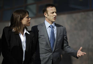 Photo - Olympic gold medal figure skater Brian Boitano, right, speaks during a news conference with fellow member of the U.S. delegation, former United States hockey player Caitlin Cahow, ahead of the opening ceremony at the 2014 Winter Olympics, Friday, Feb. 7, 2014, in Sochi, Russia. (AP Photo/David Goldman)