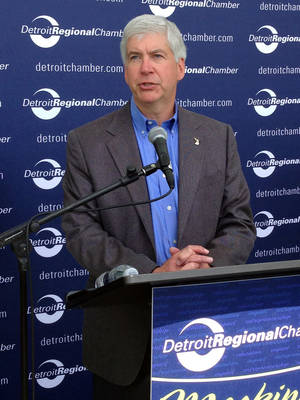 Photo - Gov. Rick Snyder speaks during the Mackinac Policy Conference, Thursday, May 29, 2014 on Mackinac Island, Mich. Snyder is urging legislators to consider updating Michigan's civil rights law to prohibit discrimination because of sexual orientation or gender identity. (AP Photo/David Eggert)