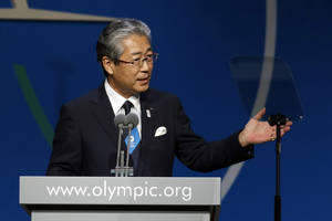 Photo - Tsunekazu Takeda,  President of Tokyo 2020 Olympic Bid Committee,  speaks during the Tokyo 2020 bid presentation during the International Olympic Committee session in  Buenos Aires, Argentina, Saturday, Sept. 7, 2013.  Tokyo, which is making its second consecutive bid, in a race against Madrid and Istanbul, has earmarked a reserve fund of 400 billion yen ($4 billion) for the 2020 Games. Madrid is bidding for the third time in a row, while Istanbul is trying for the fifth time overall. (AP Photo/Natacha Pisarenko)