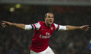 Photo - Arsenal's Theo Walcott reacts after scoring against Cardiff City during their English Premier League match, at Emirates Stadium, in London, Wednesday, Jan. 1, 2014. (AP Photo/Bogdan Maran)