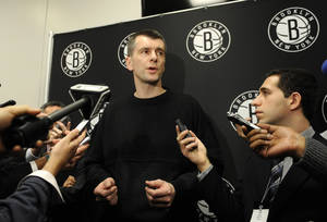 Photo - Brooklyn Nets principal owner Mikhail Prokhorov  speaks to the media concerning the firing of head coach Avery Johnson.  Prokhorov spoke at half time of an NBA basketball game against the Charlotte Bobcats on Friday, Dec., 28, 2012 at Barclays Center in New York. (AP Photo/Kathy Kmonicek)