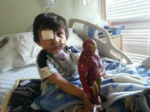 Photo - This Feb. 2014 photo provided by Flor Medrano shows Kevin Vicente in Phoenix, Ariz.  Four-year-old Kevin Vicente's road to recovery after a dog mauling on Feb. 20, 2014,  has ignited thousands of impassioned pleas, not just not for him.  The animal behind the attack is now the object of a Facebook page that has garnered more than 39,000 likes on Facebook.  The fate of Mickey the pit bull will ultimately be decided in a court hearing March 25 in Phoenix.  Guadalupe Villa, who was at the scene of the attack, has filed a vicious-animal petition to have the dog put down.  Doctors say the attack has left the boy unable to swallow properly or open one eye.  They say Kevin faces months, if not years, of reconstructive surgery.(AP Photo/)