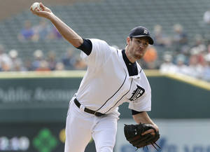 Photo - FILE - In this Sept. 19, 2013, file photo, Detroit Tigers starting pitcher Doug Fister throws against the Seattle Mariners during a baseball game in Detroit. The Tigers have traded Fister to the Washington Nationals for three players announced Monday, Dec. 2. (AP Photo/Paul Sancya, File)