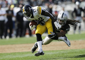 Photo -   Pittsburgh Steelers running back Chris Rainey runs with the ball, but is stopped by Oakland Raiders outside linebacker Philip Wheeler during the second quarter of an NFL football game in Oakland, Calif., Sunday, Sept. 23, 2012. (AP Photo/Marcio Jose Sanchez)