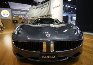 Photo - FILE - In this Nov. 18, 2010, file photo, Fisker Automotive's Fisker Karma, a sports luxury plug-in hybrid car, is displayed at the 2010 Los Angeles Auto Show in Los Angeles.  Hybrid Technology, led by Hong Kong billionaire Richard Li, has offered $55 million in an auction of Fisker Automotive's assets, just days after a bankruptcy judge in Delaware rejected Hybrid's plan to take over the failed electric-vehicle manufacturer in a private sale. (AP Photo/Damian Dovarganes, File)