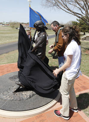 Photo - Girl Scouts from Troop 929 help sculptor Shan Gray unveil a statue that was rededicated at Mitch Park in Edmond. Photo By Paul Hellstern, The Oklahoman