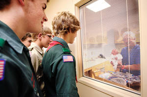 photo - Boy Scouts from Troop 21 look through a viewing window at Ryson Wilson, who was born to Rocky and Rayna Wilson, of Guthrie, on Oct. 4 at Integris Health Edmond. PHOTO BY JIM BECKEL, THE OKLAHOMAN ARCHIVES