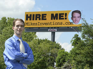 photo - Facing a job market that remains bleak for recent graduates, Mike Thompson took out ad space on a billboard on the Broadway Extension near NW 50 St.  PHOTO PROVIDED
