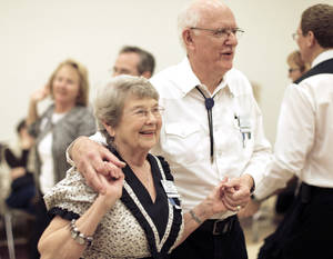 photo - Judy and Robert Mascho dance during a Teacup Chains Square Dance Club open house at Peace Lutheran Church in Edmond.  Photo by Sarah Phipps, The Oklahoman