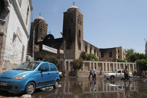 Photo - The damaged Prince Tadros Church is seen a day after it was torched in sectarian violence following the dispersal of two Cairo sit-ins of supporters of the ousted Islamist President Mohammed Morsi, in Minya, south of Cairo, Egypt, Thursday, Aug. 15, 2013. Egypt faced a new phase of uncertainty on Thursday after the bloodiest day since its Arab Spring began, with hundreds of people reported killed and thousands injured as police smashed two protest camps of supporters of the deposed Islamist president. Wednesday's raids touched off day-long street violence that prompted the military-backed interim leaders to impose a state of emergency and curfew, and drew widespread condemnation from the Muslim world and the West, including the United States. (AP Photo/Roger Anis, El Shorouk Newspaper) EGYPT OUT
