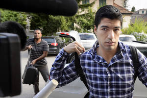 Photo - Uruguay's soccer player Luis Suarez arrives for a hearing at the international Court of Arbitration for Sports, CAS, in Lausanne, Switzerland, Friday, Aug. 8, 2014. Suarez appeals to the CAS against the four-month ban imposed by FIFA on the Uruguay striker. Suarez was banned for biting Italy's Giorgio Chiellini at the Brazil 2014 World Cup. (AP Photo/Keystone, Laurent Gillieron)