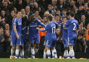 Photo - Chelsea's Demba Ba, third left, celebrates his goal against Tottenham Hotspur with teammates during their English Premier League soccer match at Stamford Bridge, London, Saturday, March 8, 2014. (AP Photo/Sang Tan)