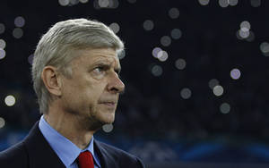 Photo - Arsenal's manager Arsene Wenger waits for the start of a Champions League, group F soccer match between Arsenal and Napoli, at the Naples San Paolo stadium, Italy, Wednesday, Dec. 11, 2013. (AP Photo/Andrew Medichini)