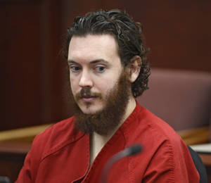 Photo - Aurora theater shooting suspect James Holmes  in court in Centennial, Colo., on Tuesday, June 4, 2013. Holmes was allowed to change his plea to not guilty by reason of insanity. (AP Photo/The Denver Post, Andy Cross, Pool)