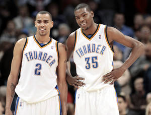Photo - Most of the Thunder players are in their early to mid-20s, including 25-year-old Thabo Sefolosha, left, and 21-year-old Kevin Durant.  Photo by Doug Hoke, The Oklahoman