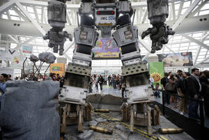 Photo - A replica of a robot from the video game Titanfall stands in the lobby area as show attendees wait in line to enter the Electronic Entertainment Expo in Los Angeles, Wednesday, June 12, 2013. (AP Photo/Jae C. Hong)